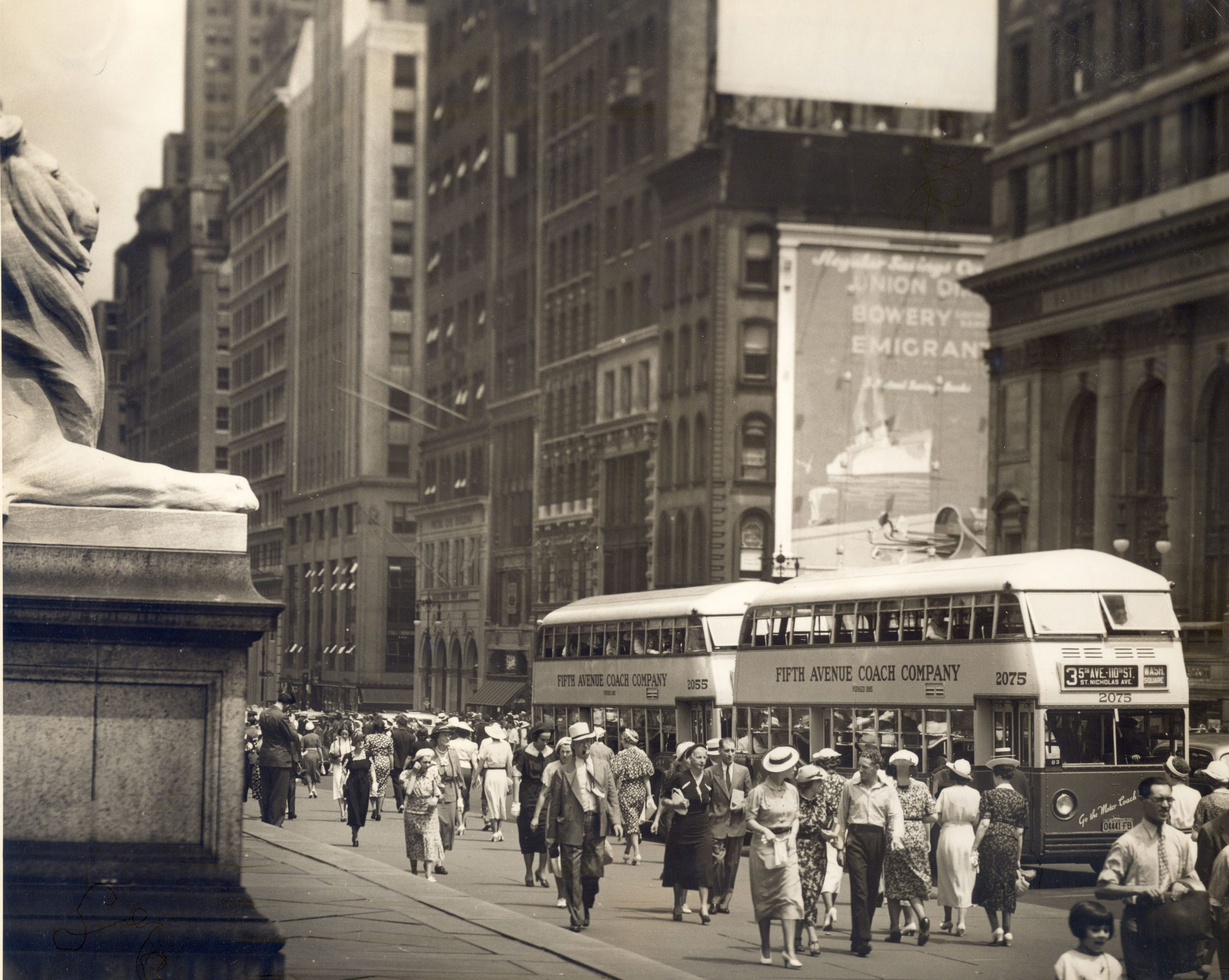 double decker buses outside new york library