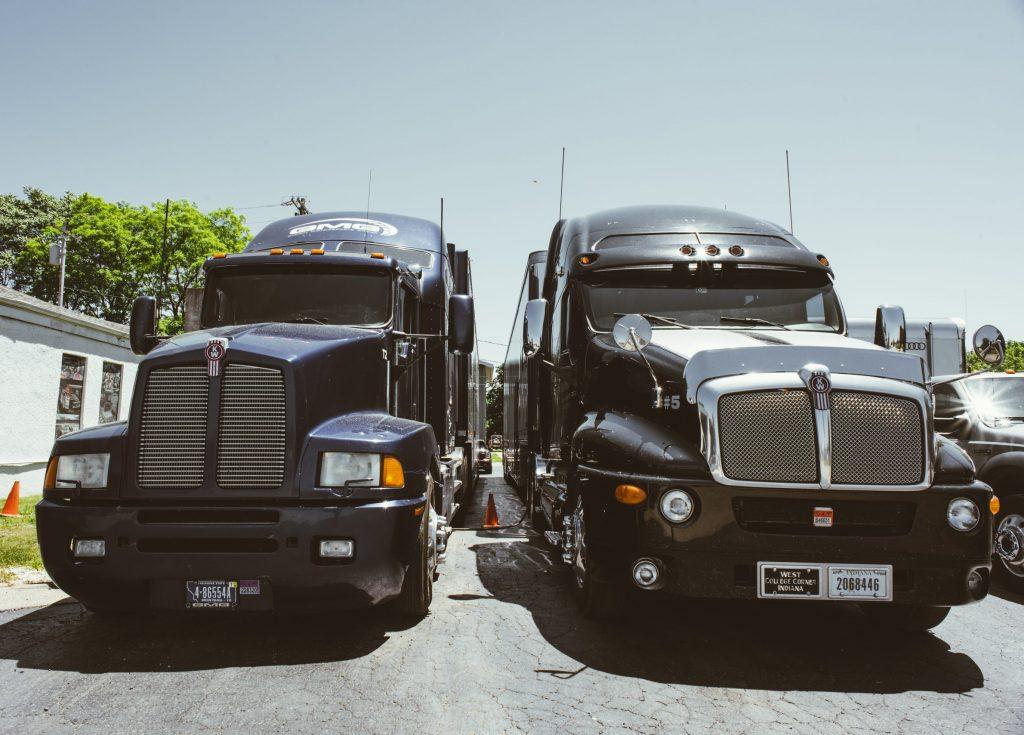 enclosed car hauling semi trucks front
