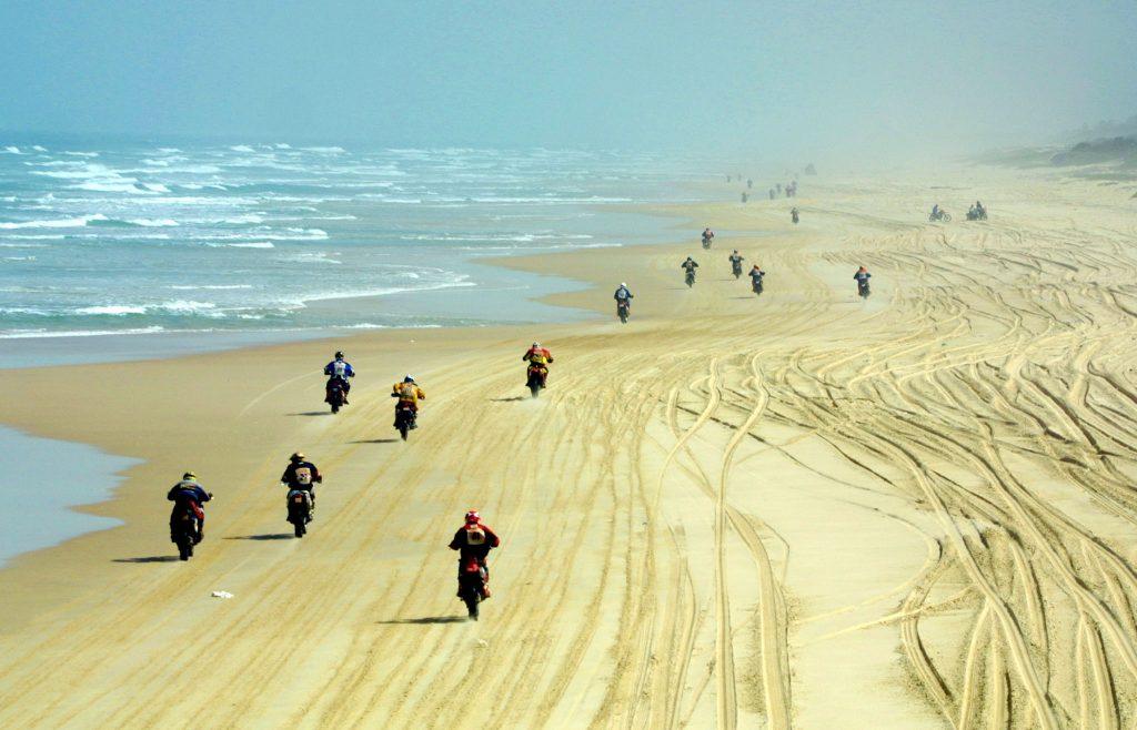 Motorcyclists Dakar rally beach last leg start