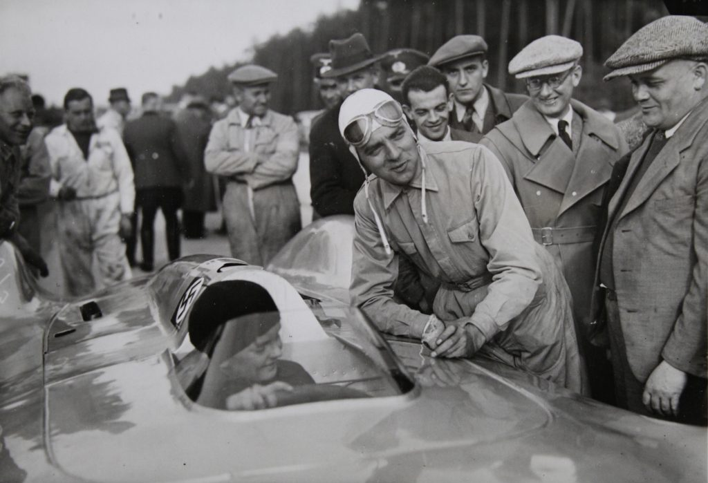German Racing Driver Bernd Rosemeyer and boy laugh