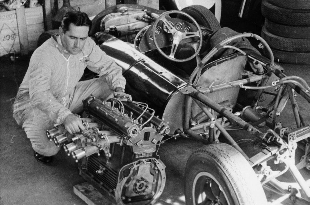 Jack Brabham inspecting engine