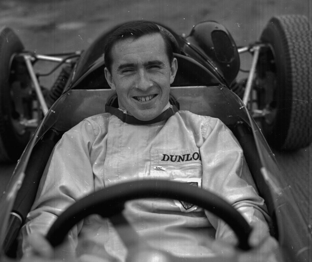 Jackie Stewart in driving overalls