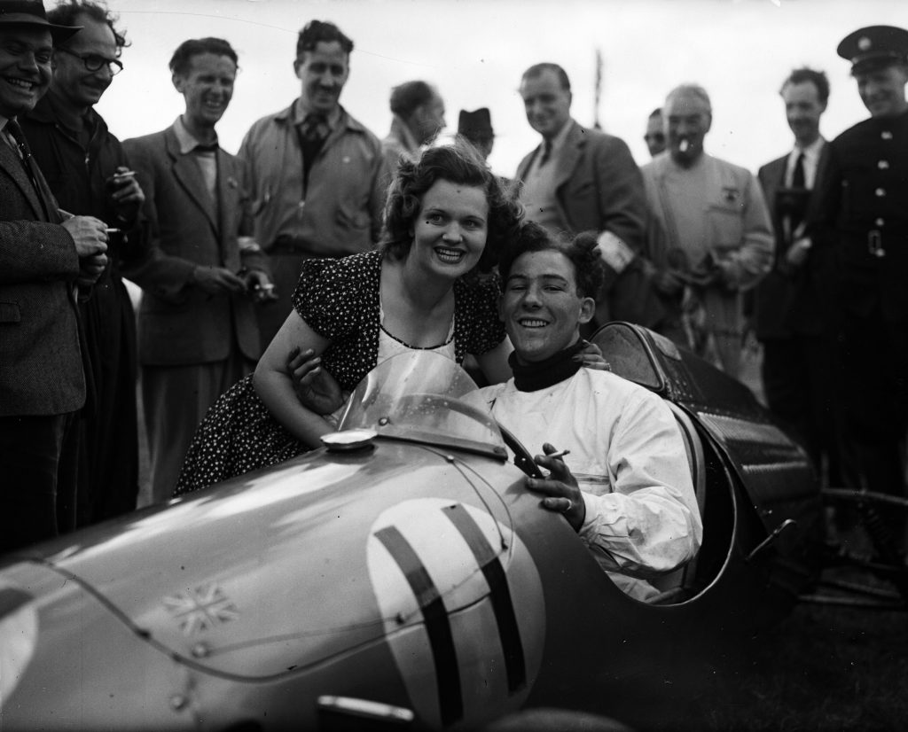 Stirling Moss being congratulated by Mrs John Cooper