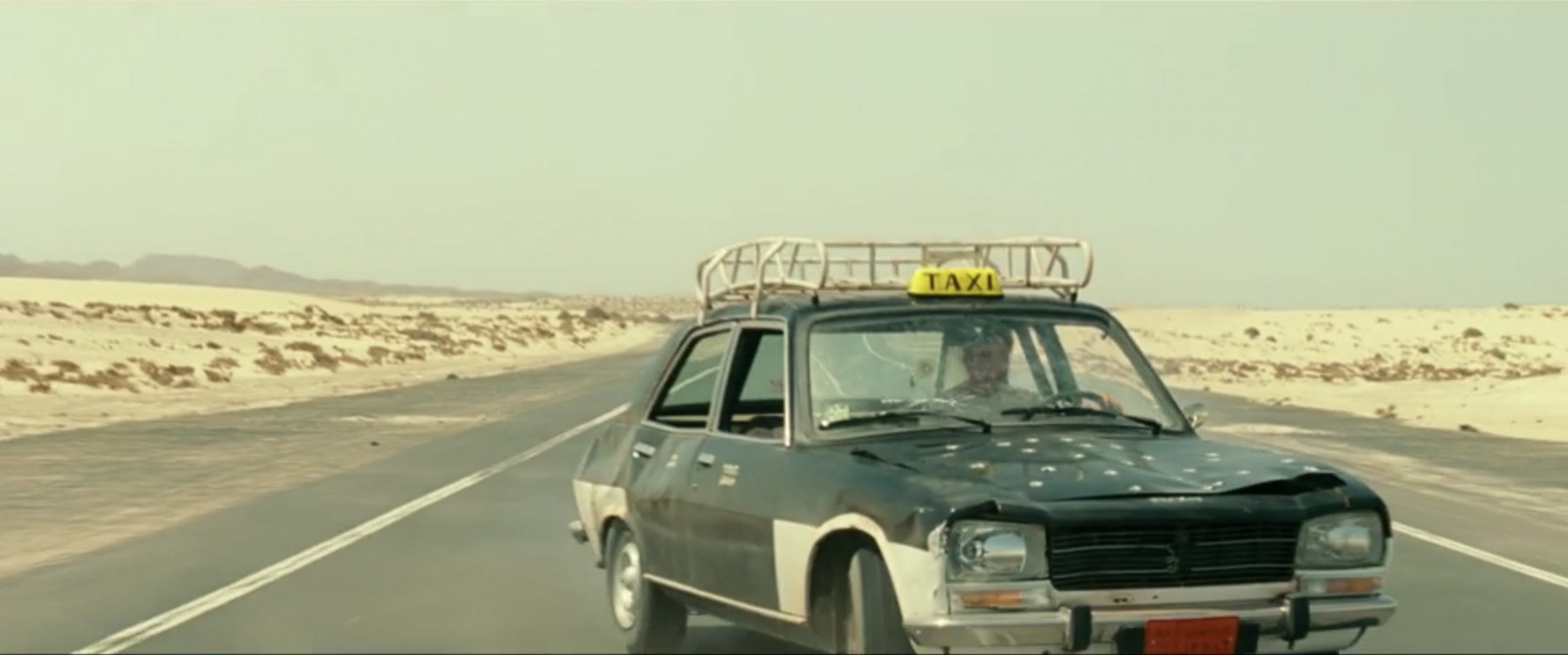 chris pine taxi chase scene bullet holes action