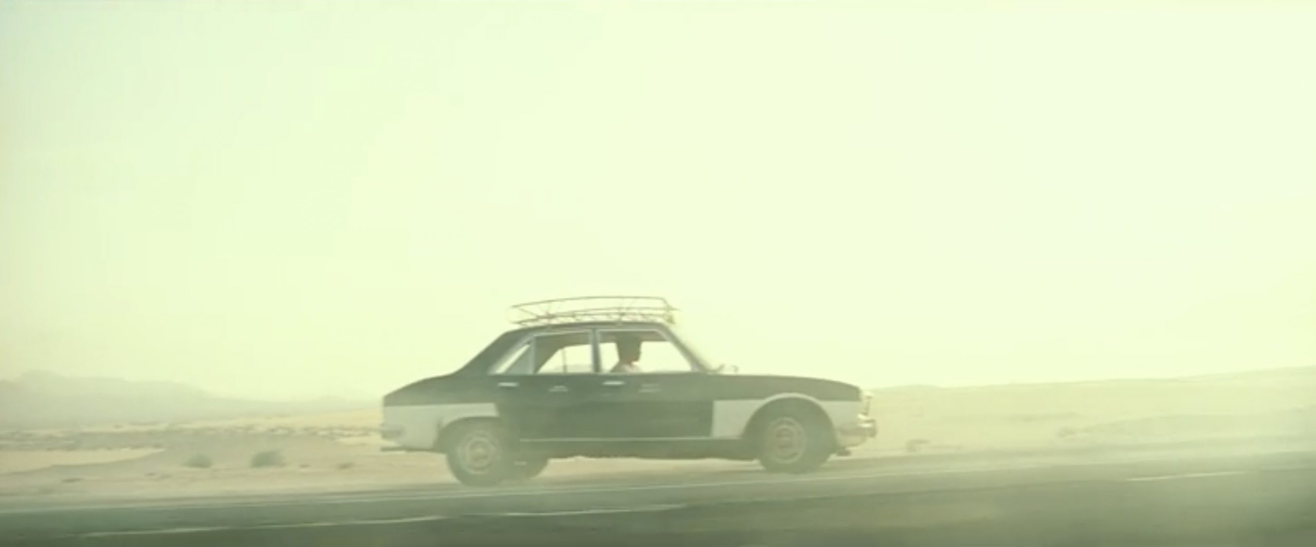 chris pine taxi chase scene dust cloud action