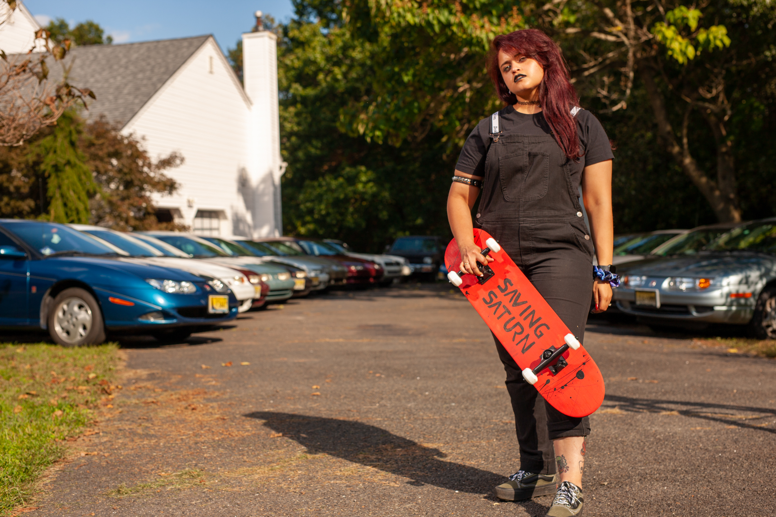 saturn enthusiast jessie skateboard standing profile