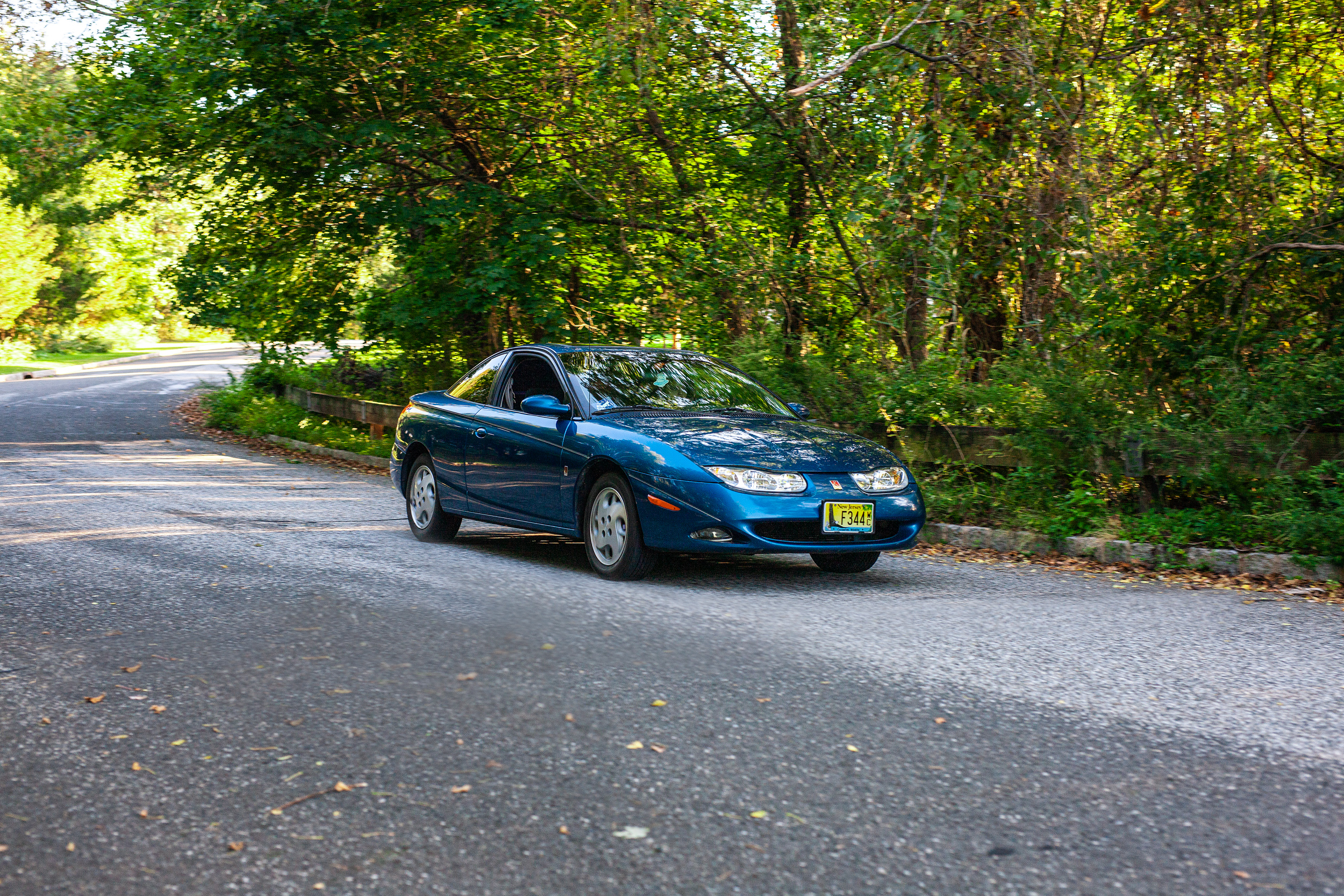 blue saturn coupe front three-quarter