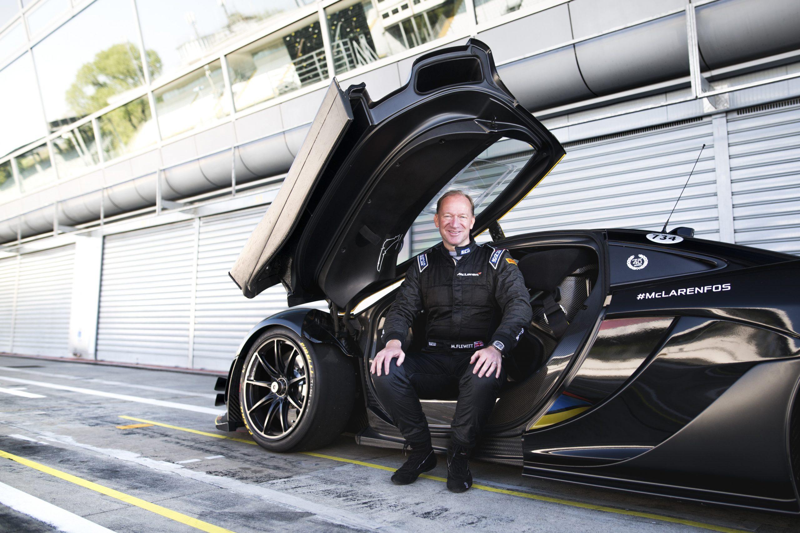 McLaren CEO Mike Flewitt sitting in a McLaren