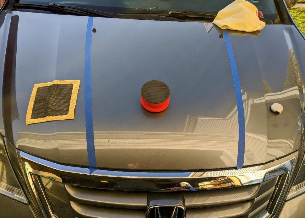 three car detail products split between taped zones