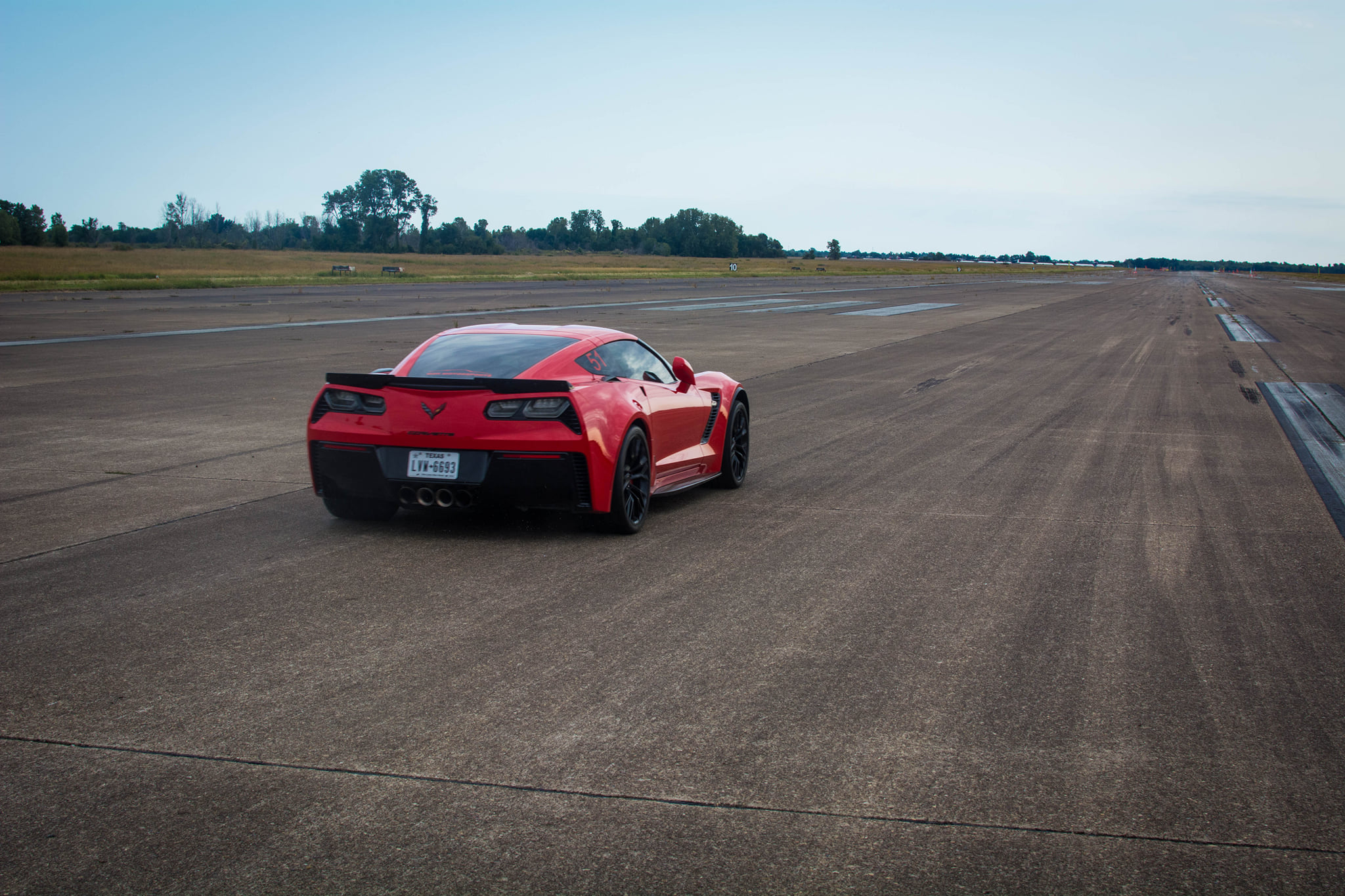 Red Corvette on an Airstrip