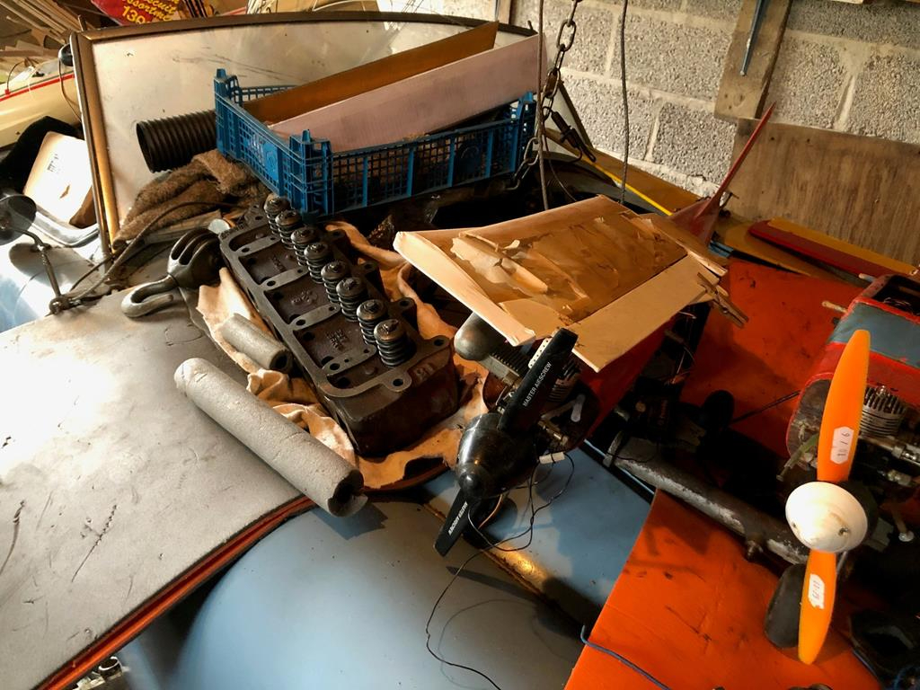 1960 MGA roadster parts and junk on car hood