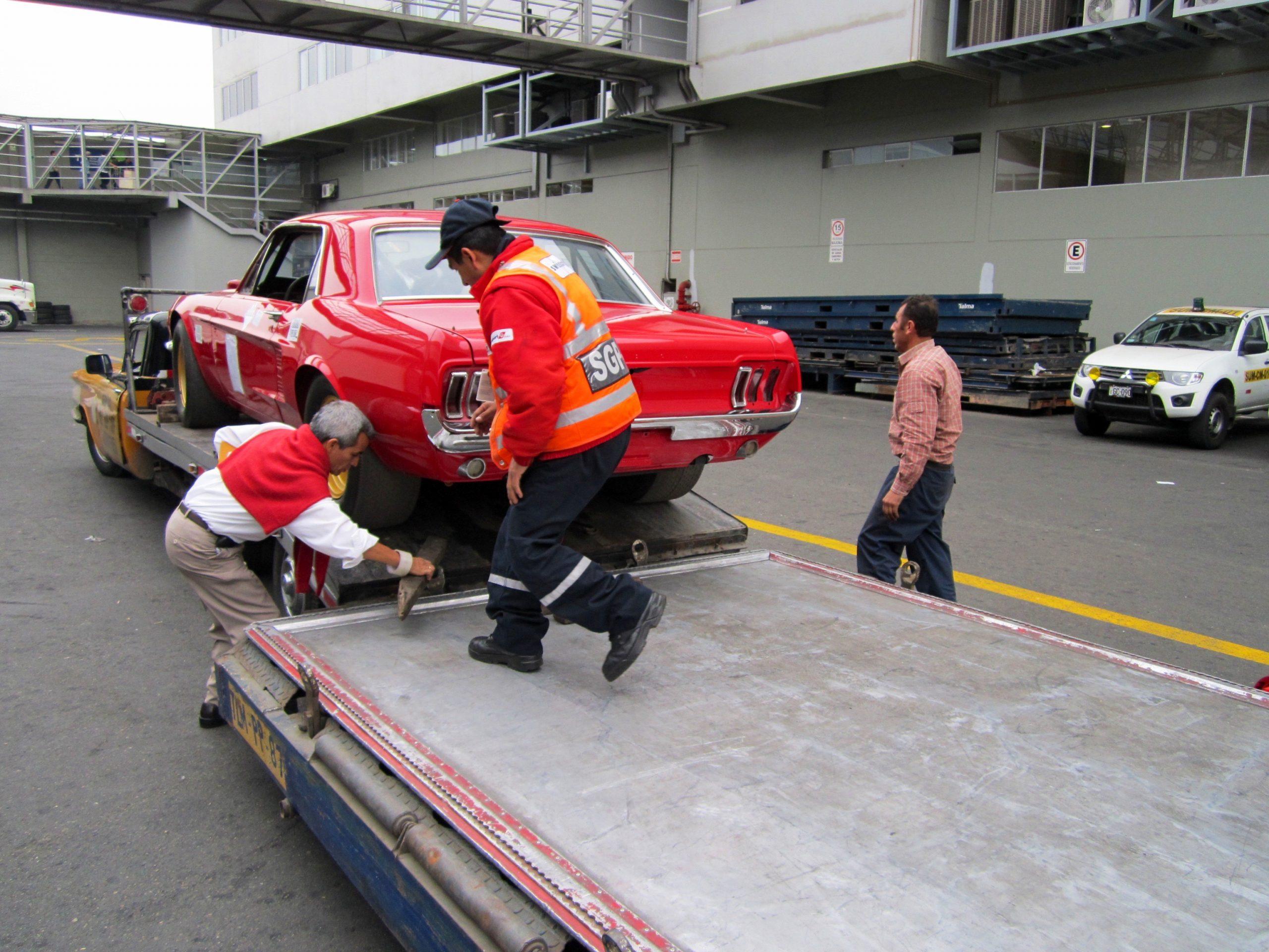 1967 Holman-Moody Mustang Batman loaded on carrier rear