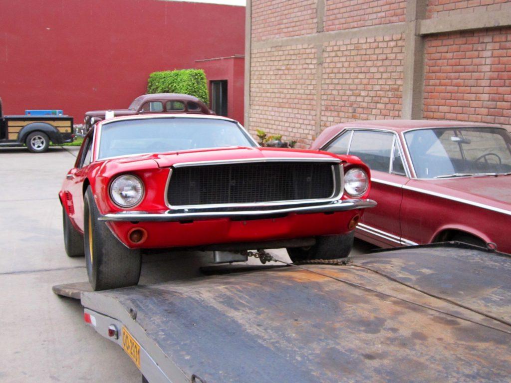 1967 Holman-Moody Mustang Batman loading on carrier front