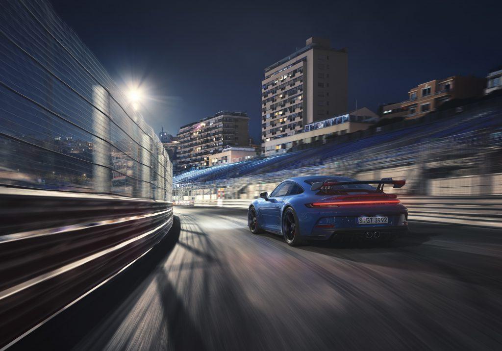 2022 Porsche 911 GT3 on track rear three quarter