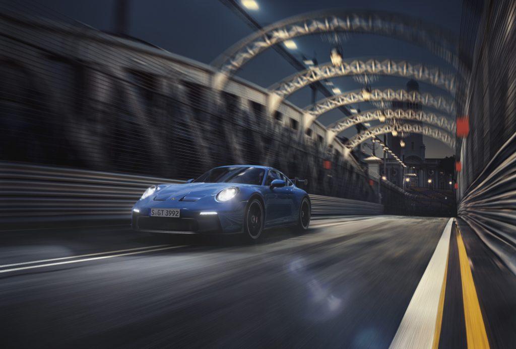 2022 Porsche 911 GT3 at speed front three quarter
