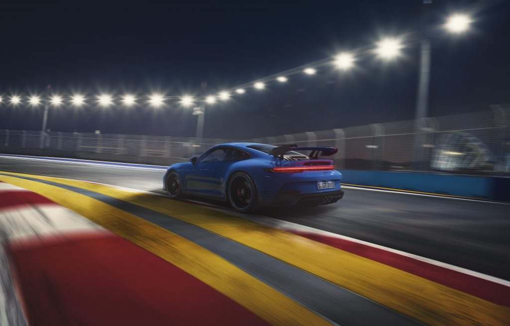 2022 Porsche 911 GT3 on track rear side profile