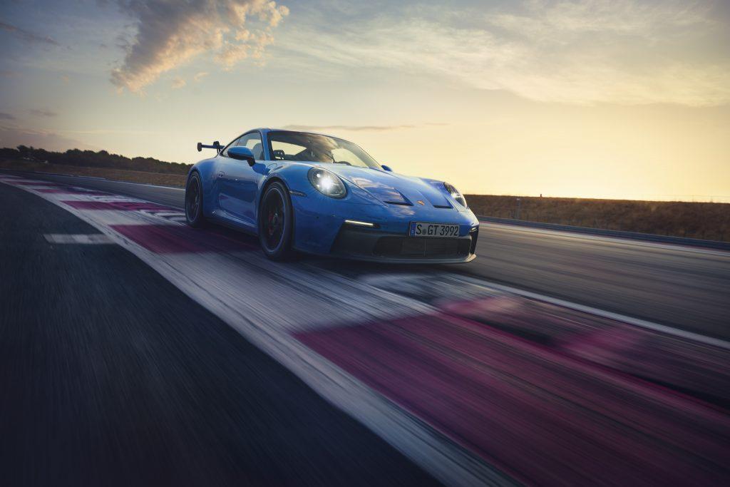 2022 Porsche 911 GT3 front three quarter over curb