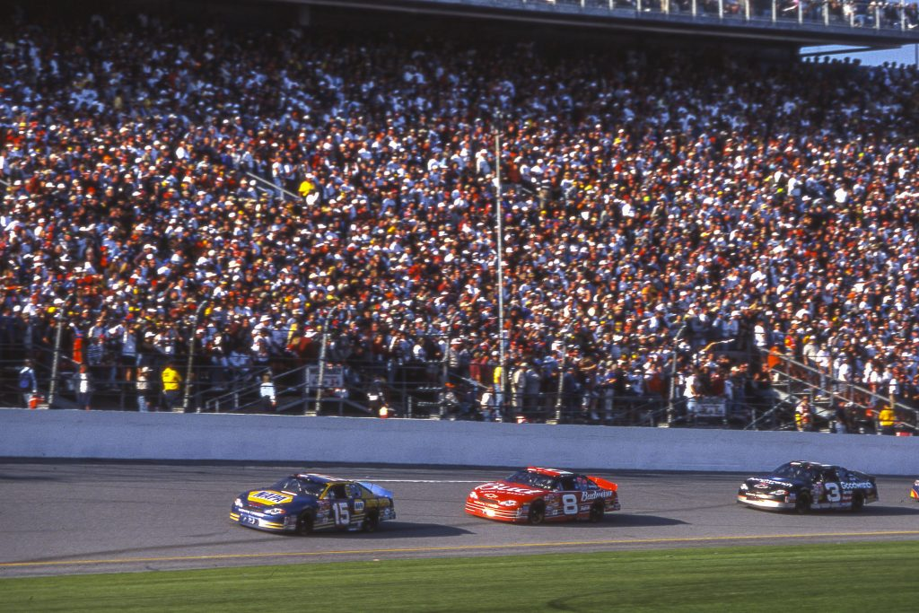 Dale Earnhardt drafting behind dale jr and waltrip