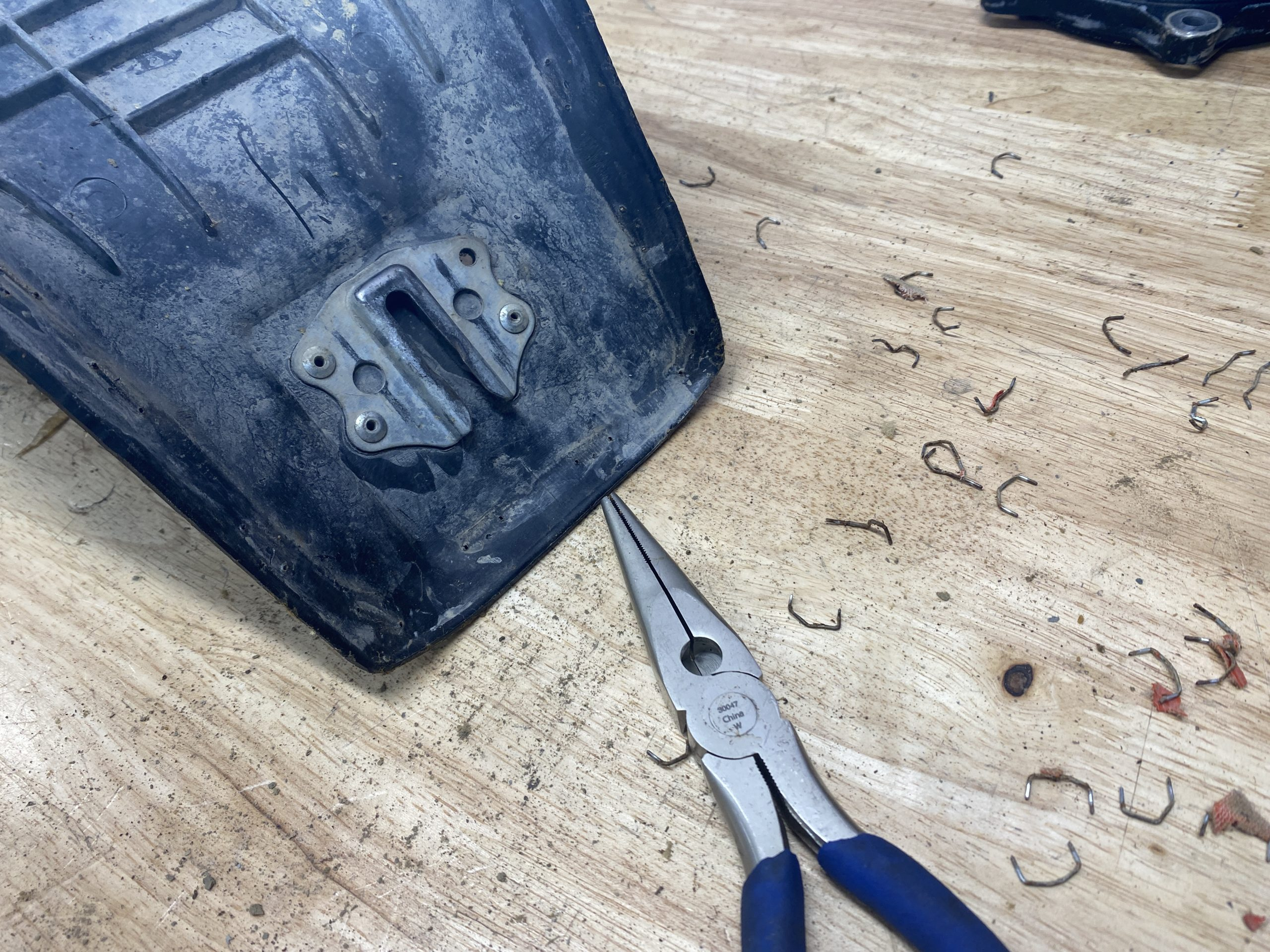 pulling old staples from XR250 seat pan