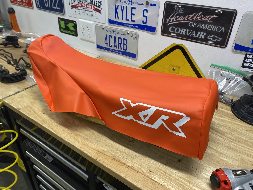 fitting cover on XR250 seat
