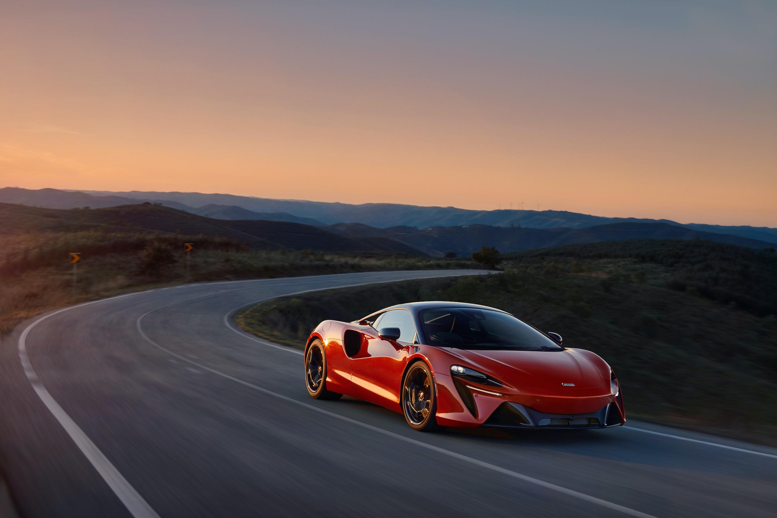 McLaren Artura orange front three-quarter sunset action
