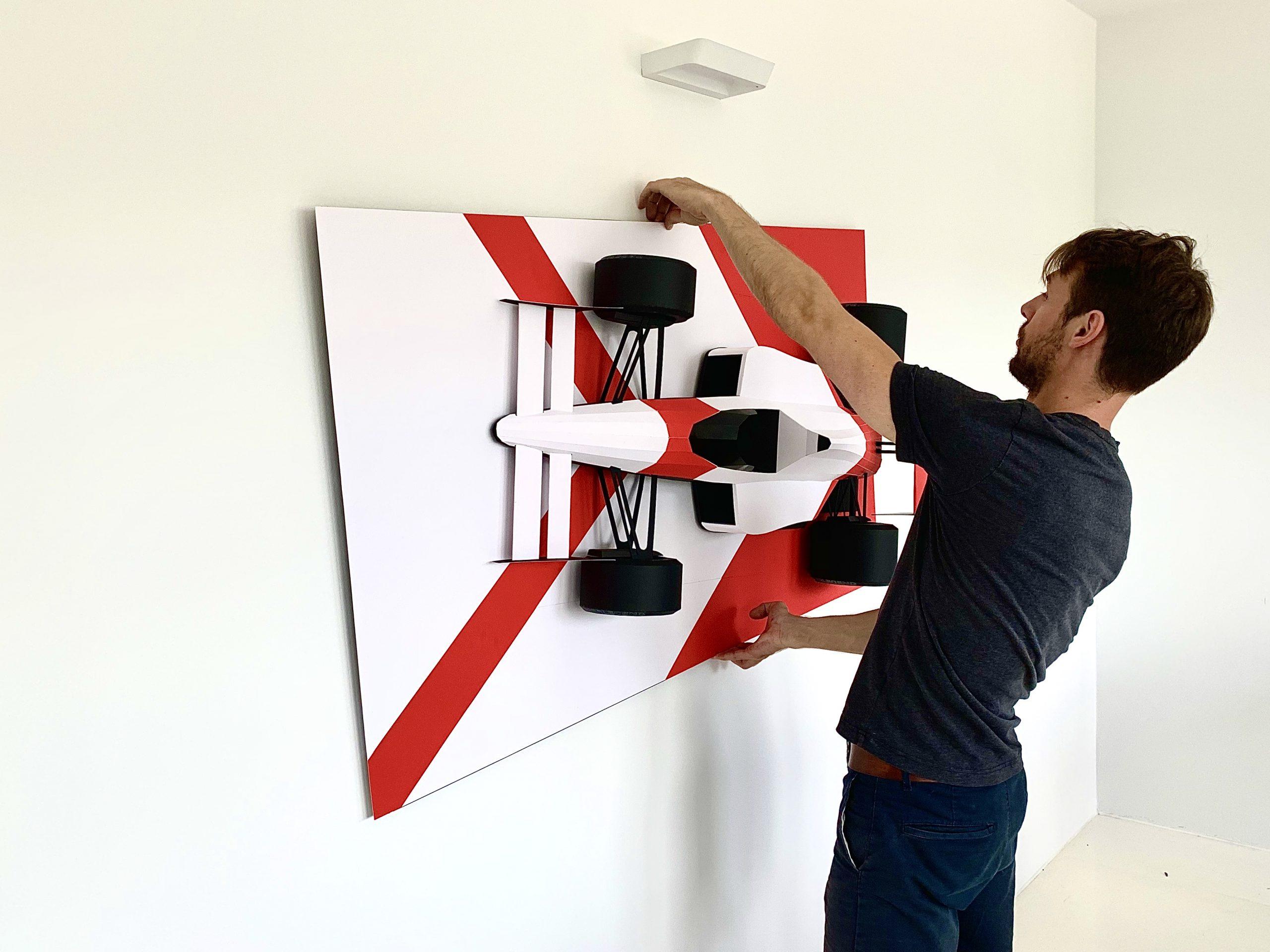 automotive paper sculptor wall hang installation