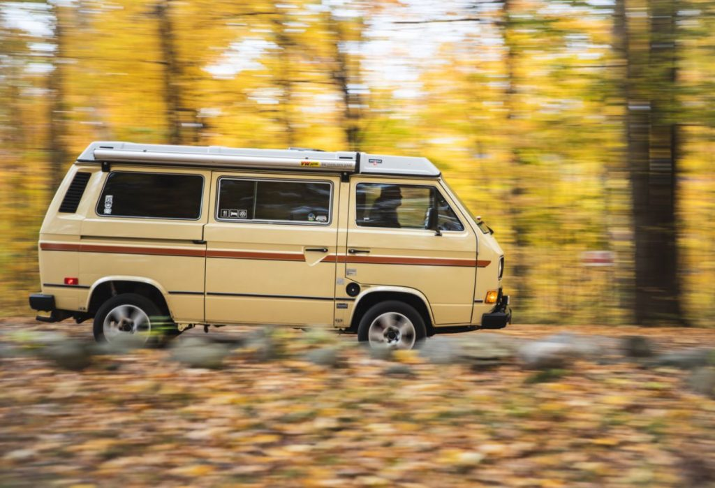 VW Vanagon driving in the woods