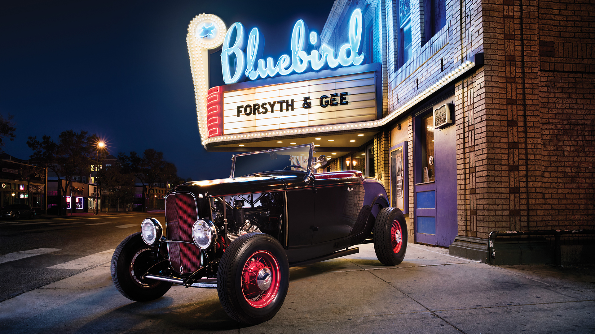 Traditional '32 Ford hot Rod in front of movie theater