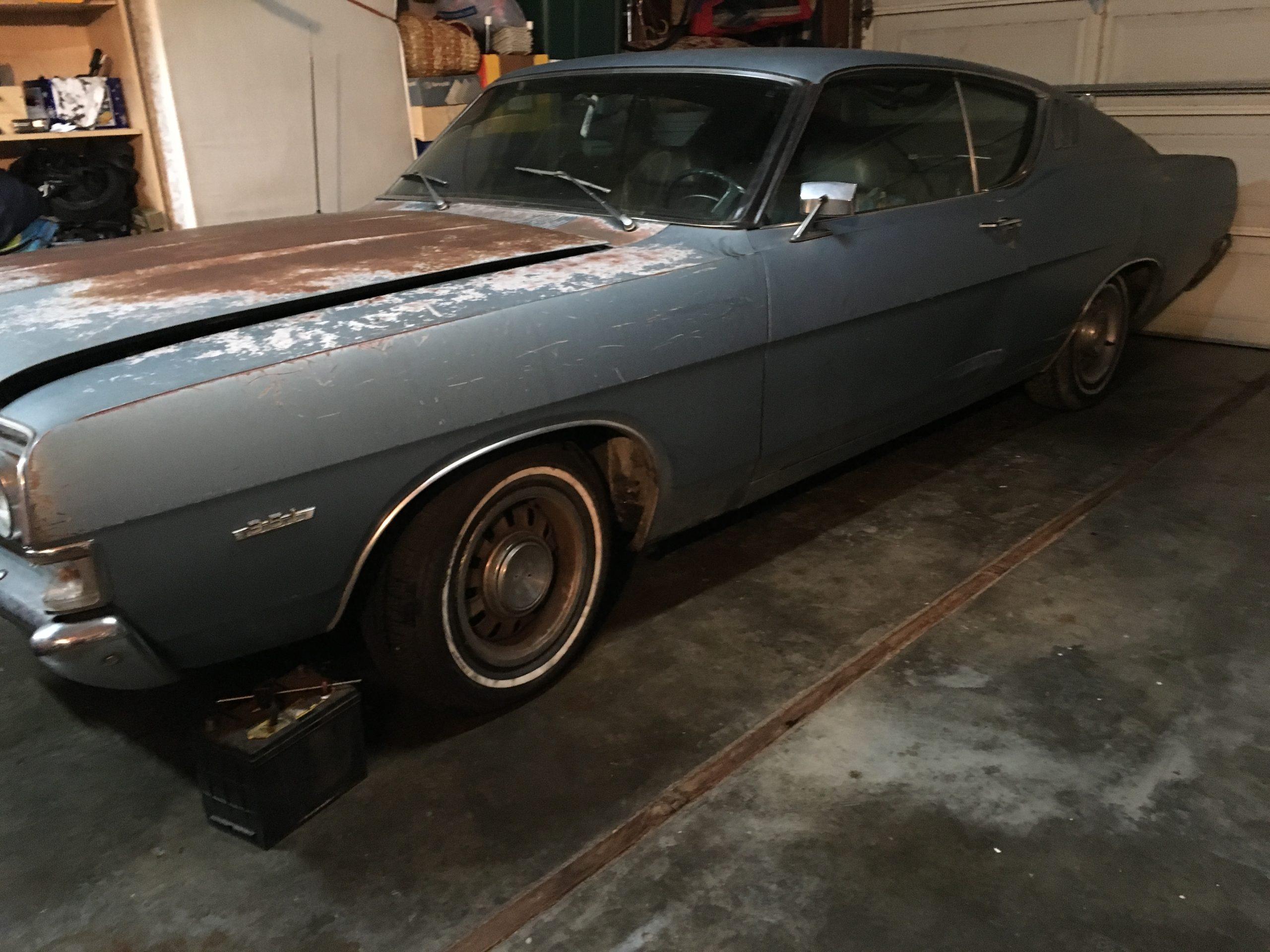 1969 Ford Torino in garage before restoration