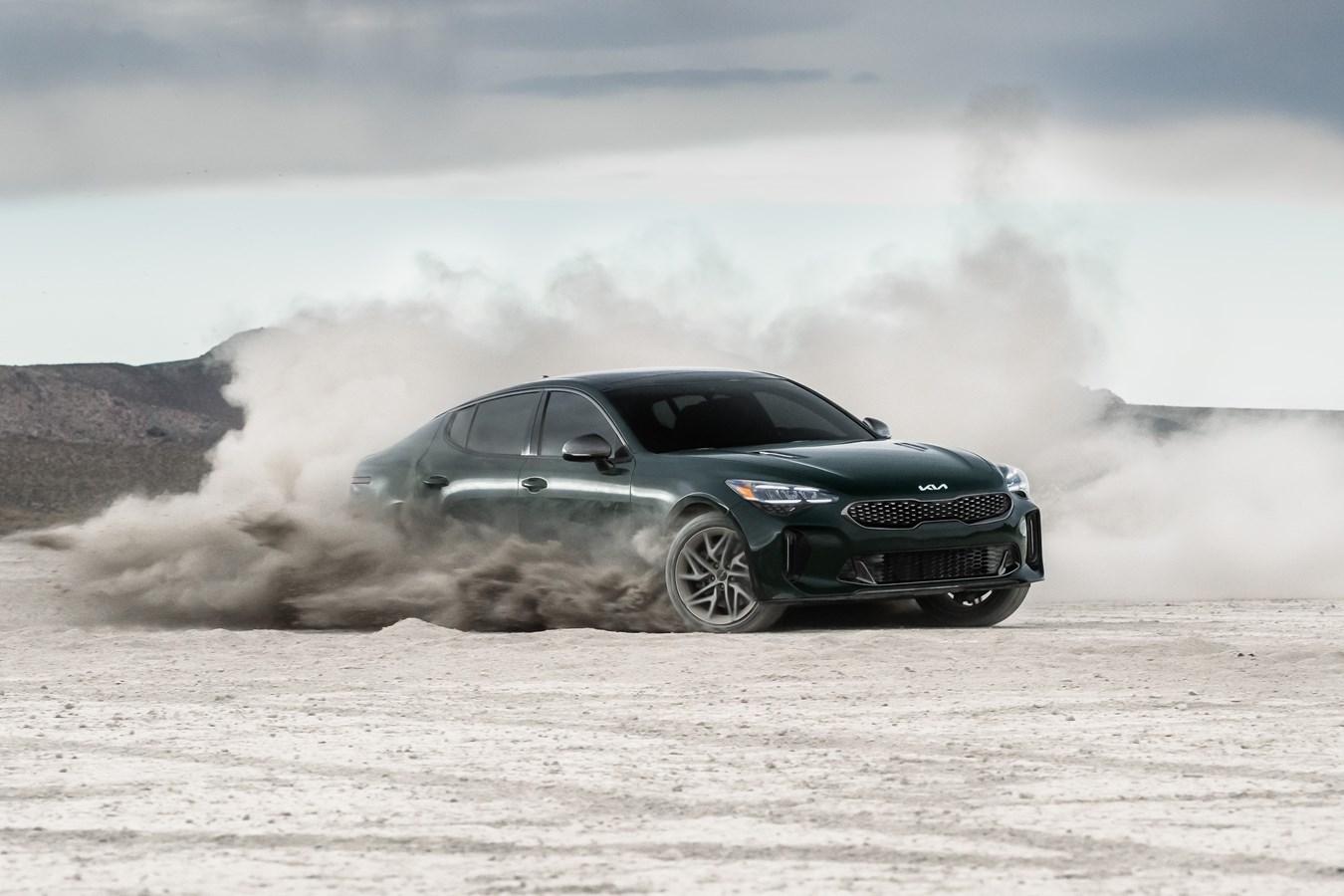 2022 Stinger GT-Line front three-quarter sand dynamic action