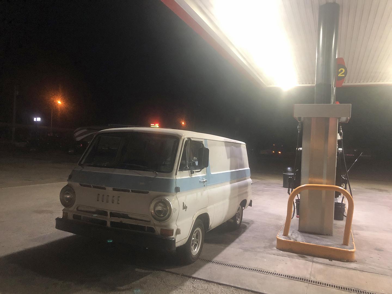 A100 Van rear three-quarter front three-quarter gas station