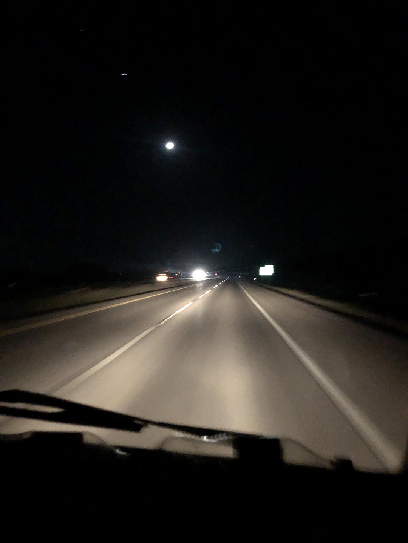A100 Van rear three-quarter interstate at night