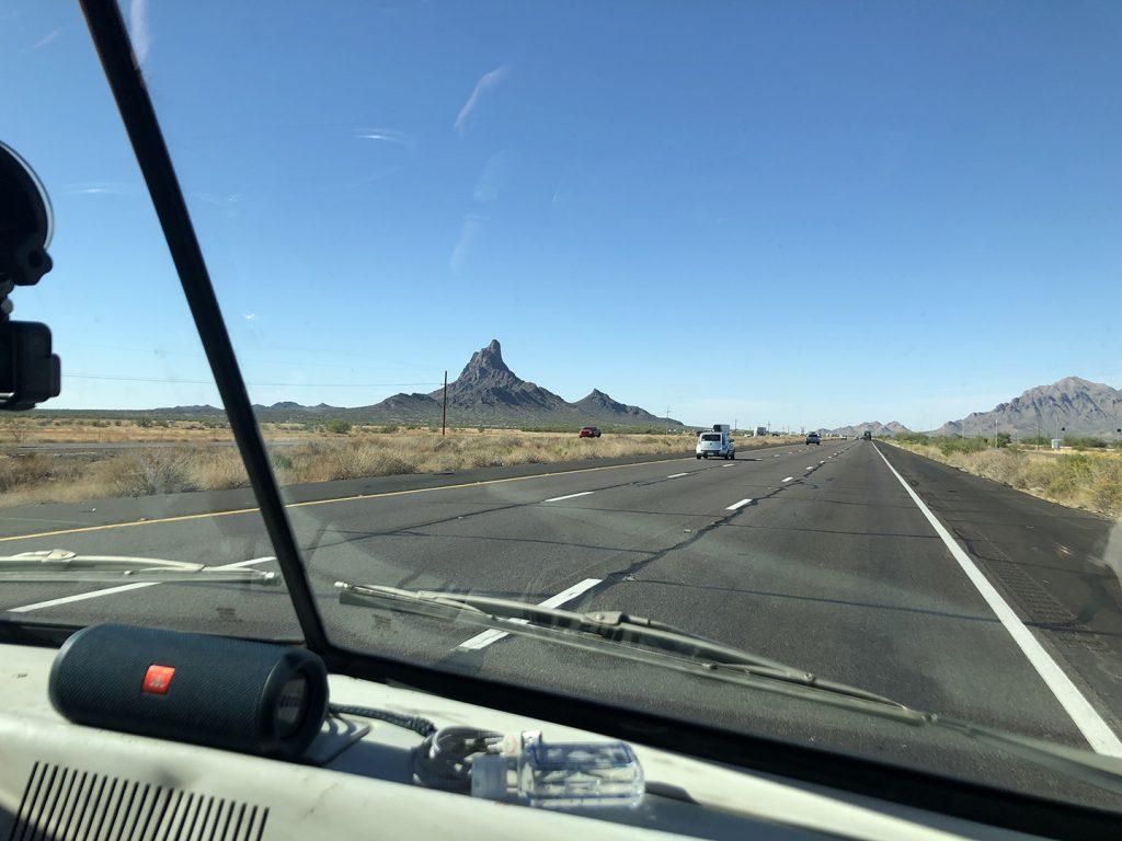 A100 Van rear three-quarter open desert highway three lanes