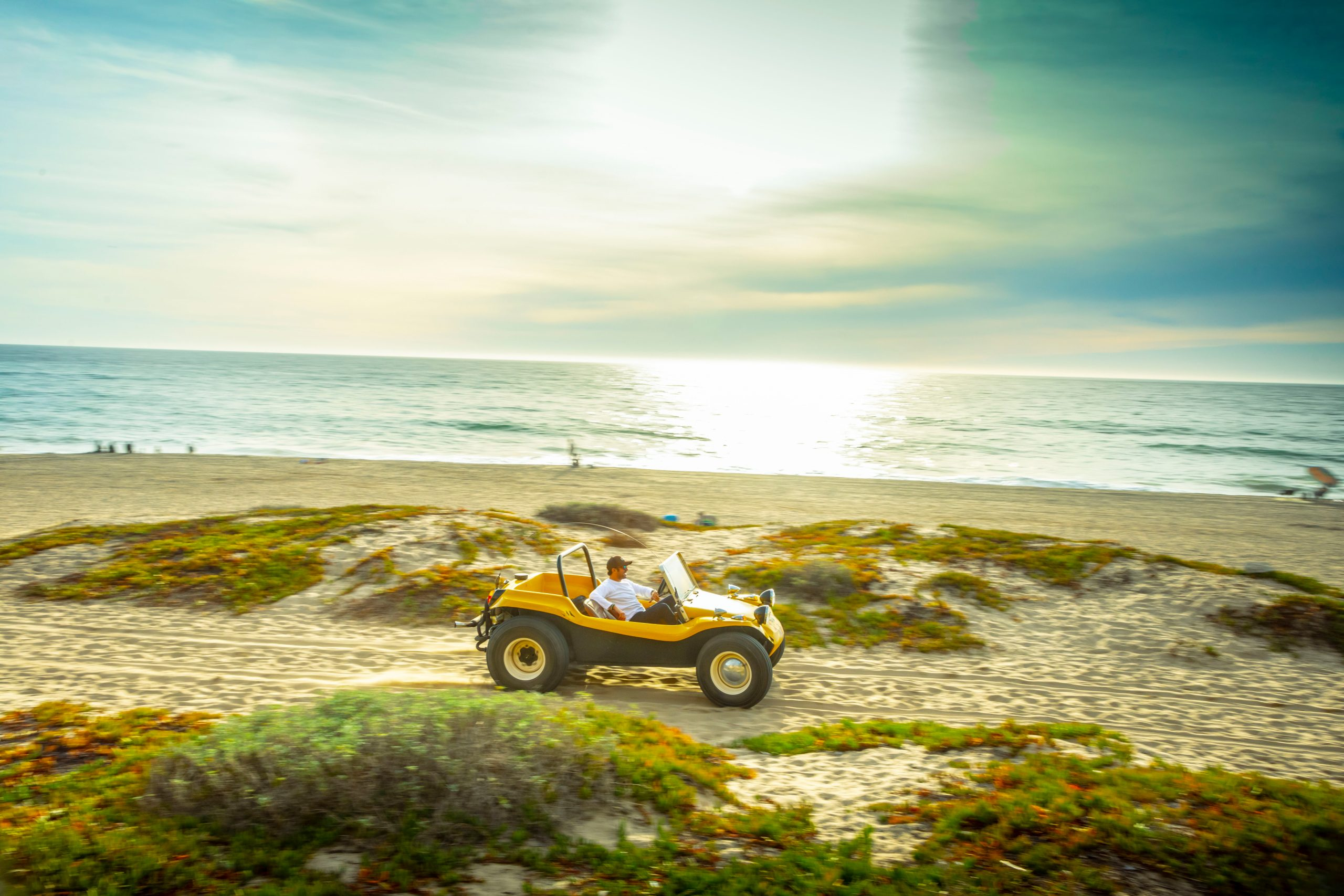 Meyers Manx Dune Buggy side on beach dune driving action