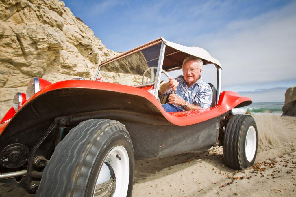 Meyers Manx Dune Buggy bruce behind wheel climbing dunes