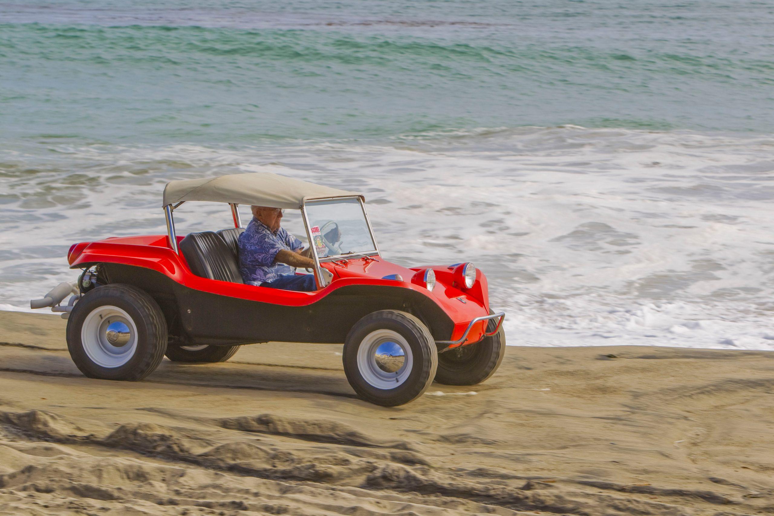 Meyers Manx Dune Buggy front three-quarter on beach bruce at wheel