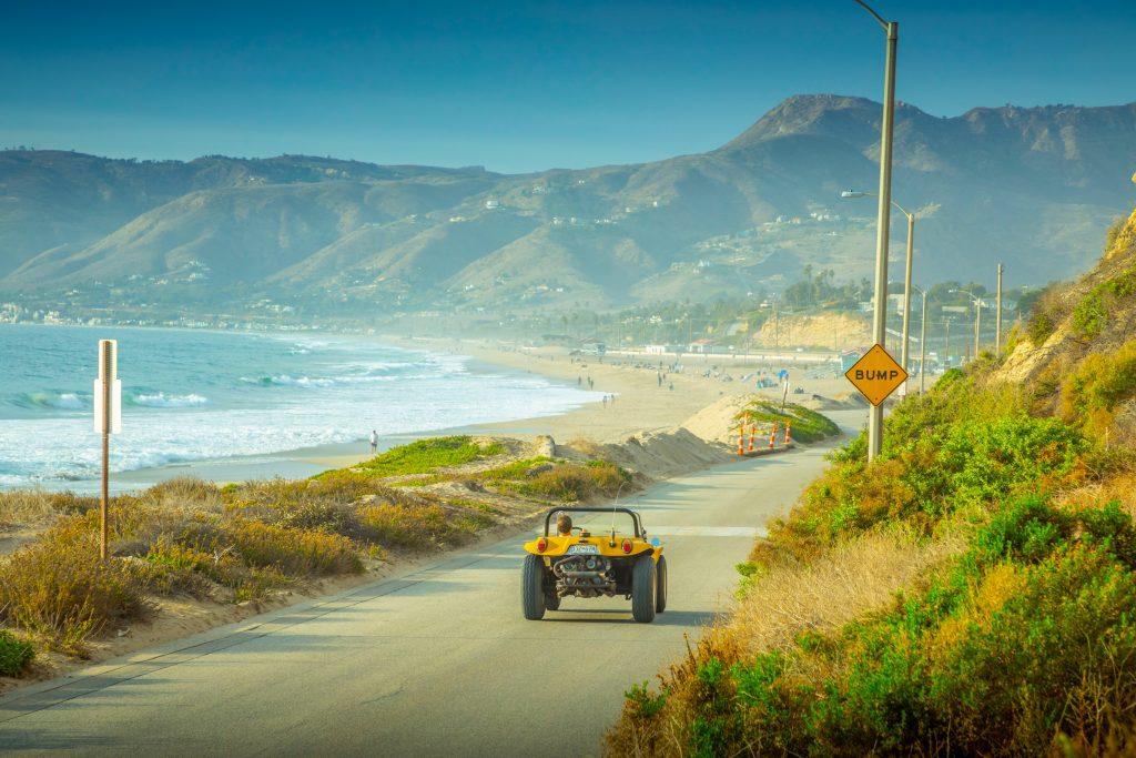 Meyers Manx Dune Buggy california coast rear driving action