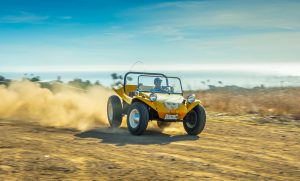 Meyers Manx Dune Buggy dirt road dusty slide action