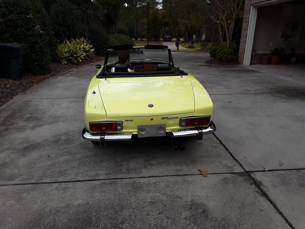 Norman Campbell yellow convertible roadster rear