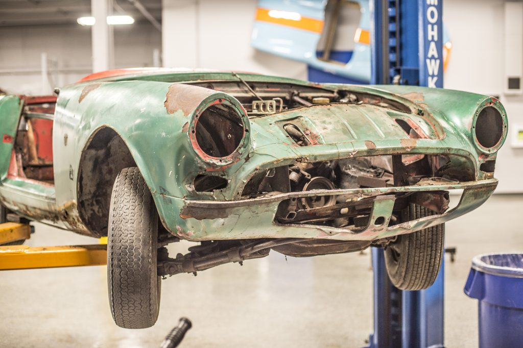 Sunbeam Tiger Hagerty Employee Restoration project car front on lift