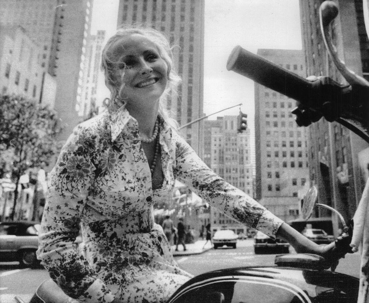 debbie lawler on bike smiling portrait