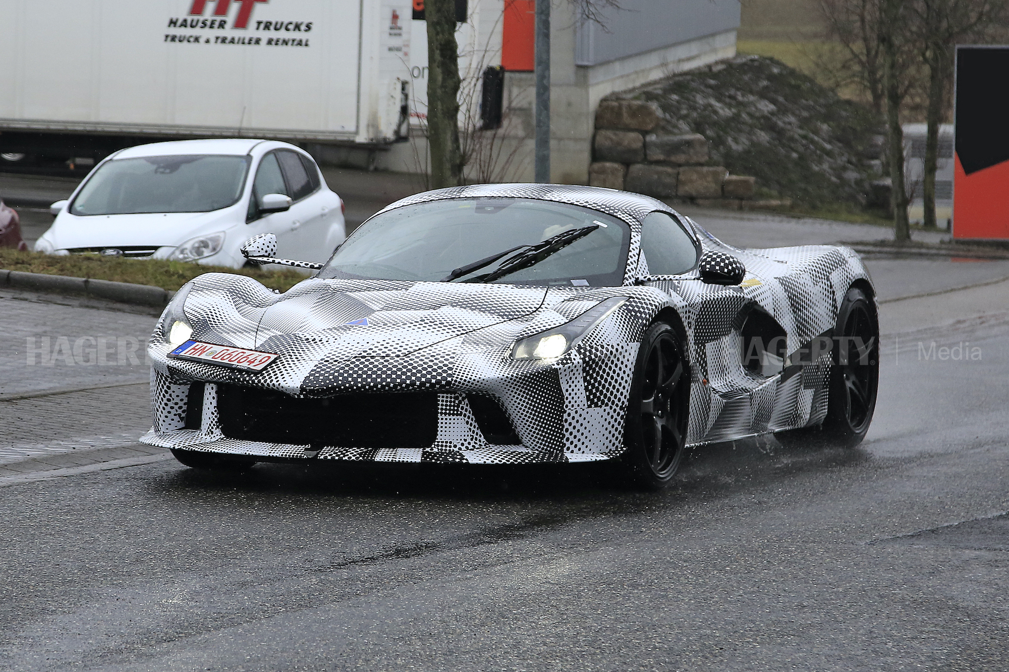 New Ferrari Hypercar Mule spy front three-quarter