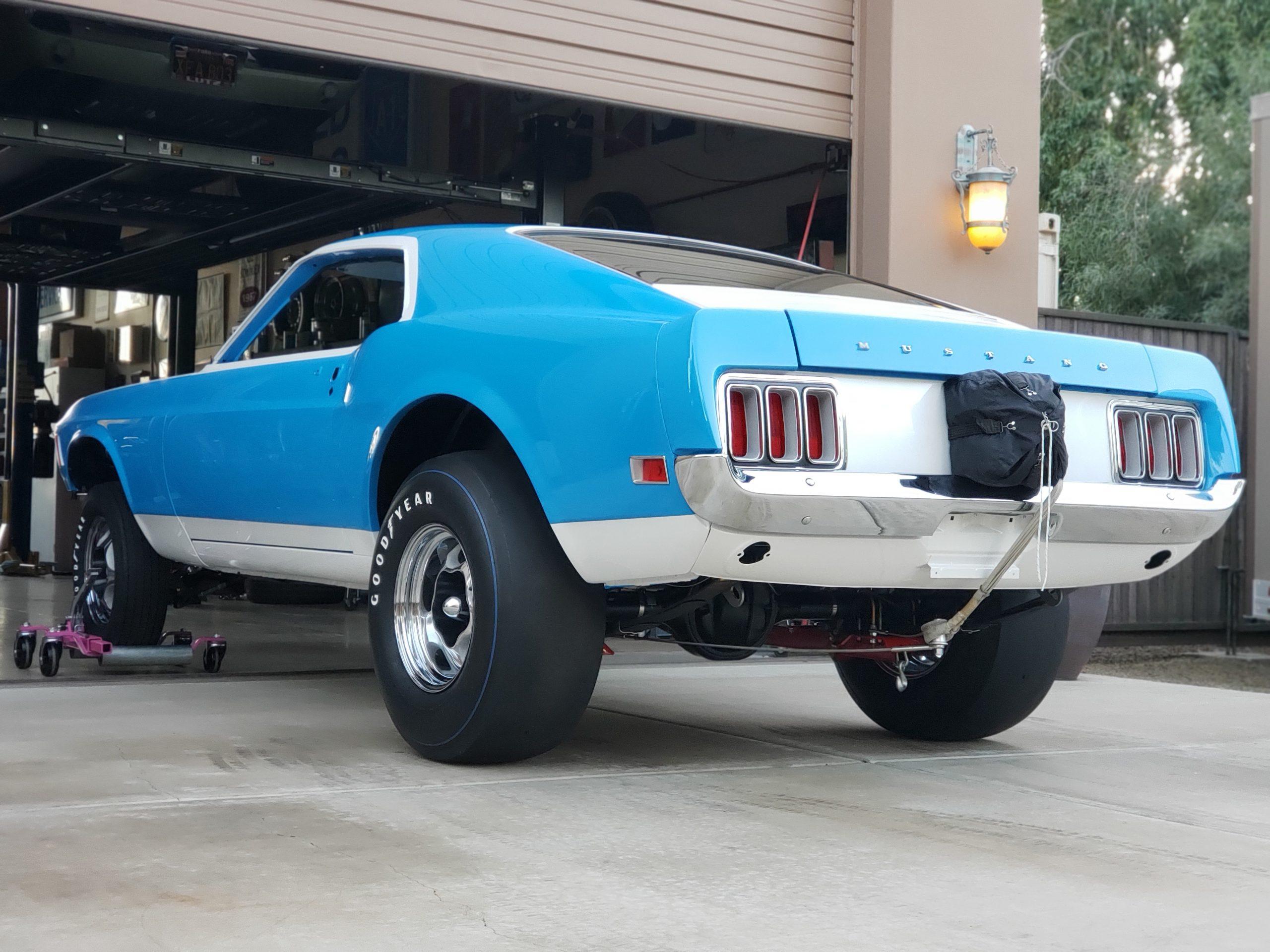Lawman Boss 429 Ford Mustang restoration rear three-quarter outside garage