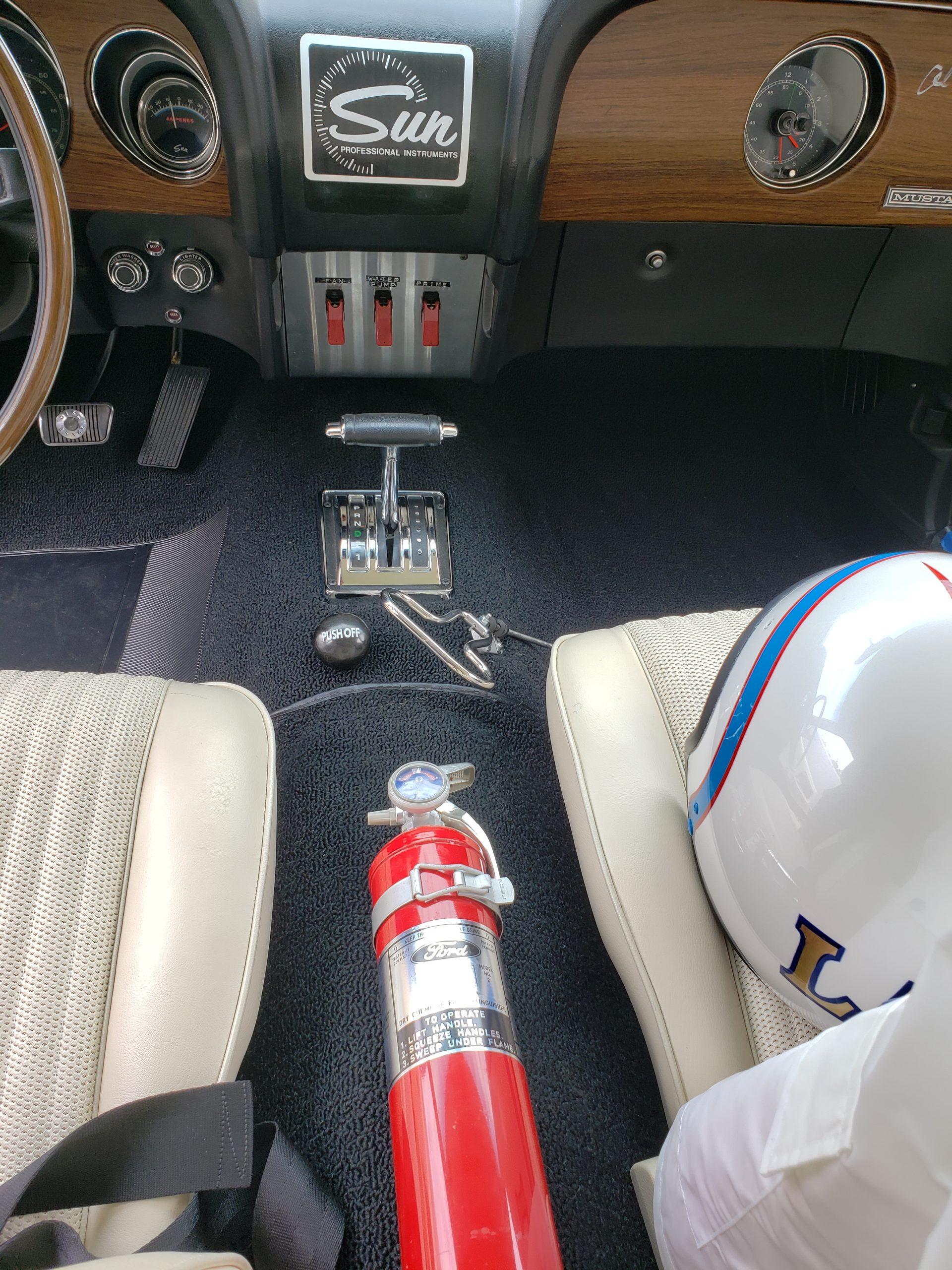 Lawman Boss 429 Ford Mustang restoration interior center shifter ridge extinguisher