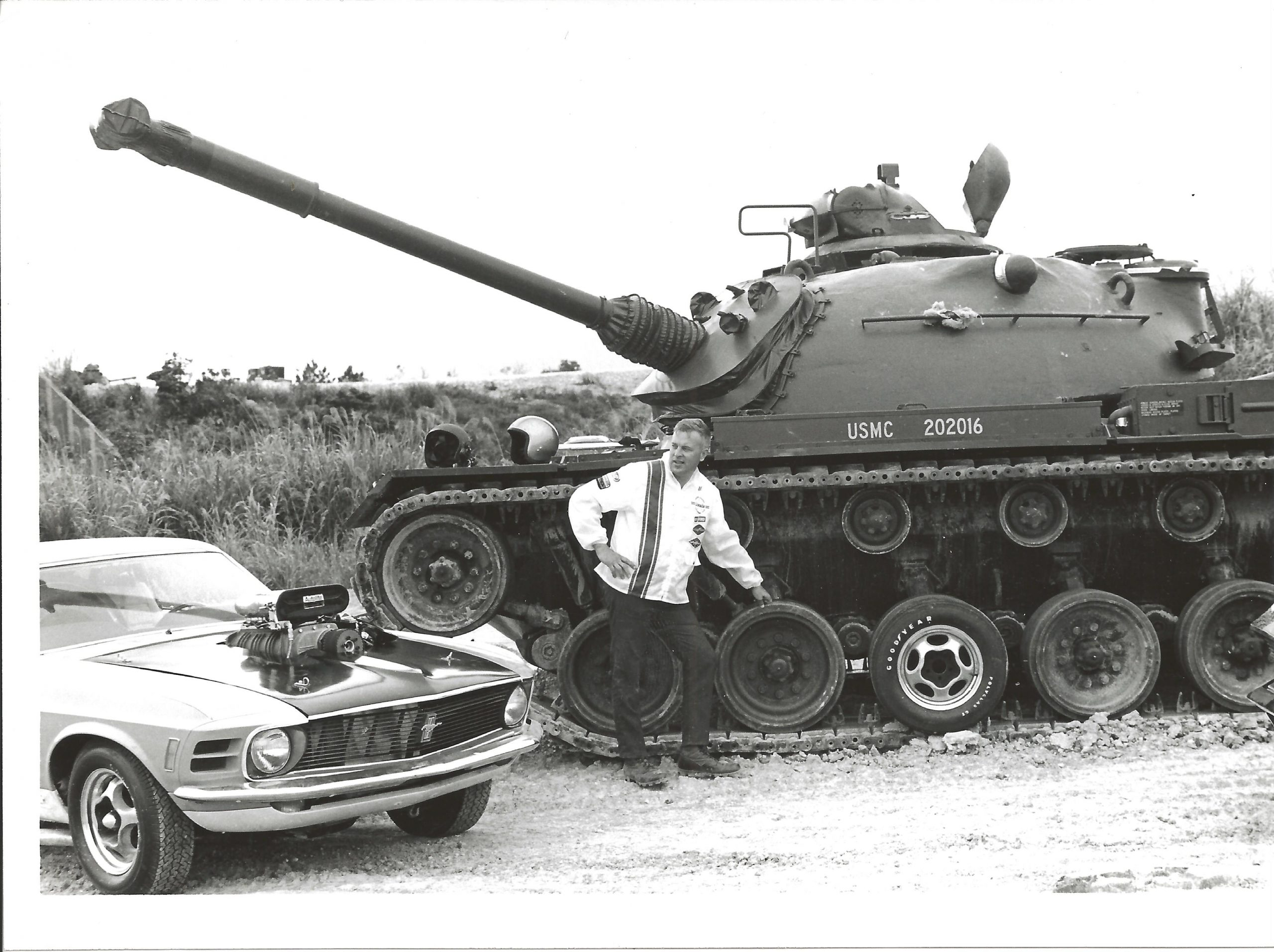 Lawman Boss 429 Ford Mustang historical car beside USMC battle tank black and white
