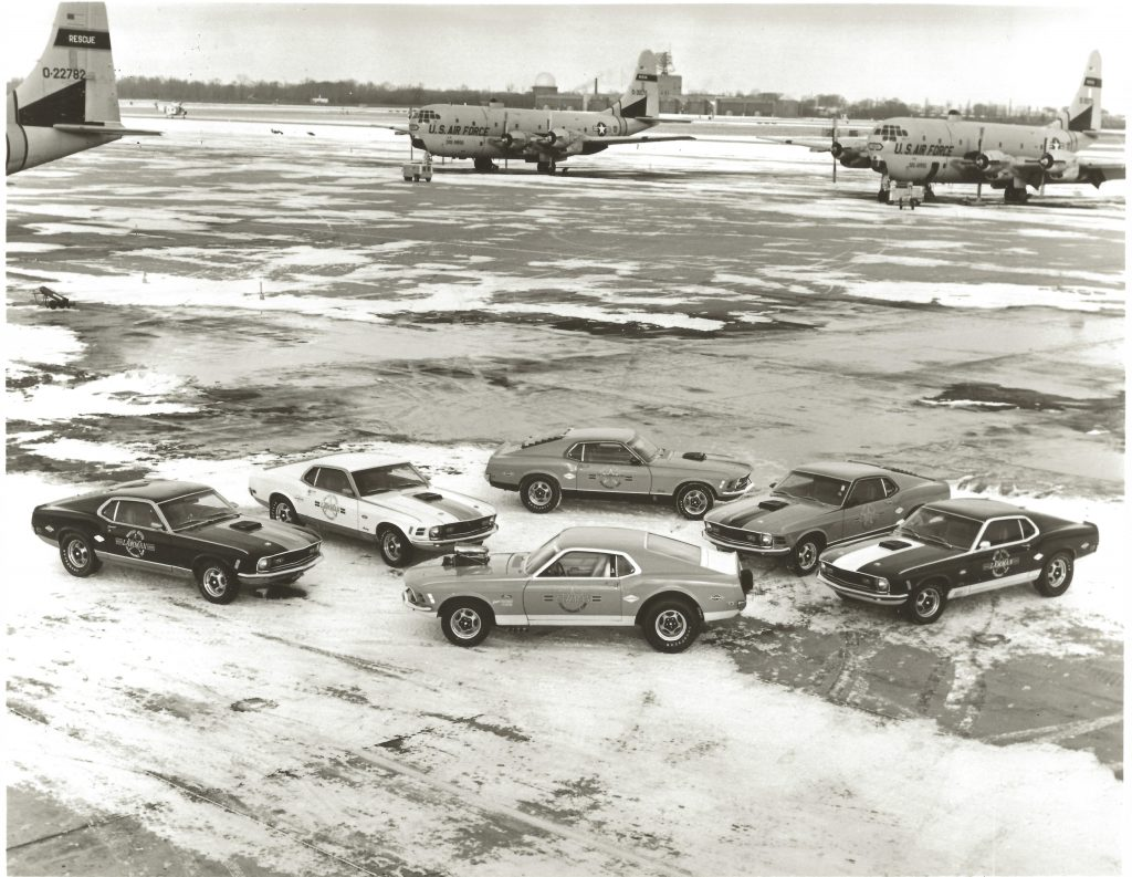 Lawman Boss 429 Ford Mustang historical cars arranged on us air force tarmac