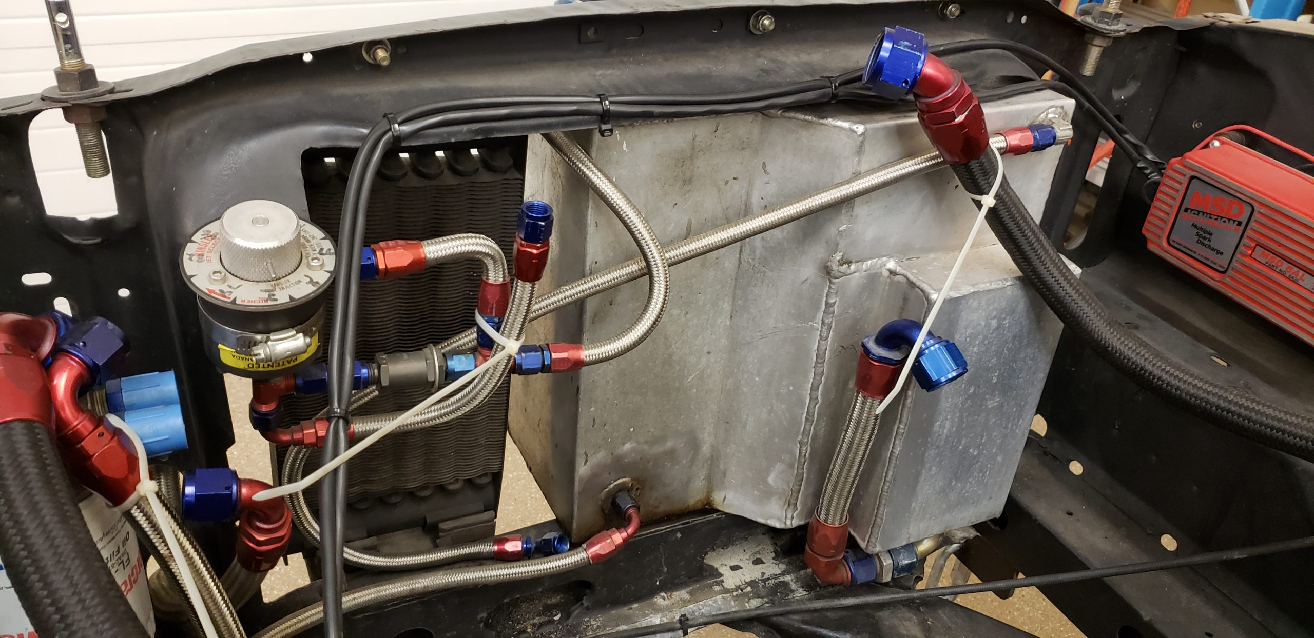 Lawman Boss 429 Ford Mustang restoration engine bay hoses close
