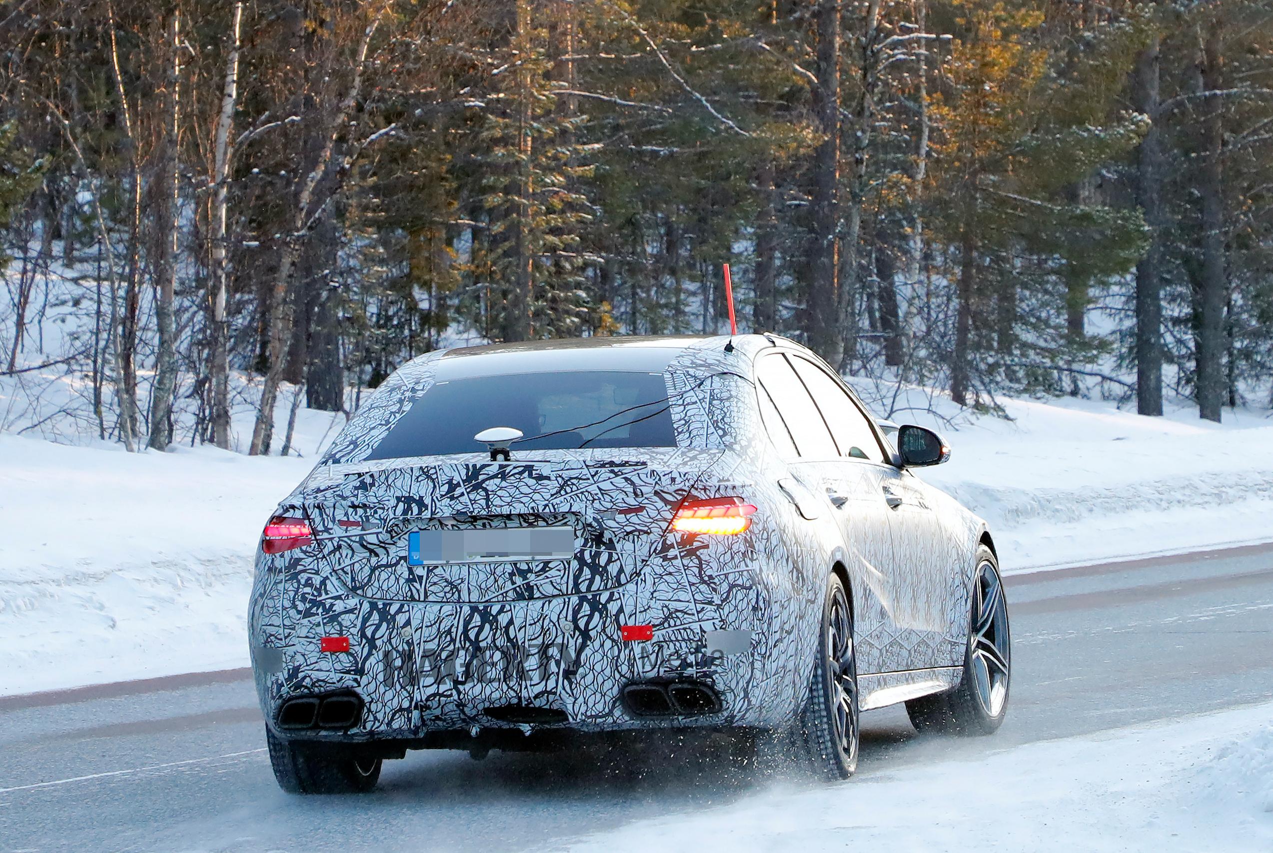 Mercedes AMG C63e camo spy rear three-quarter