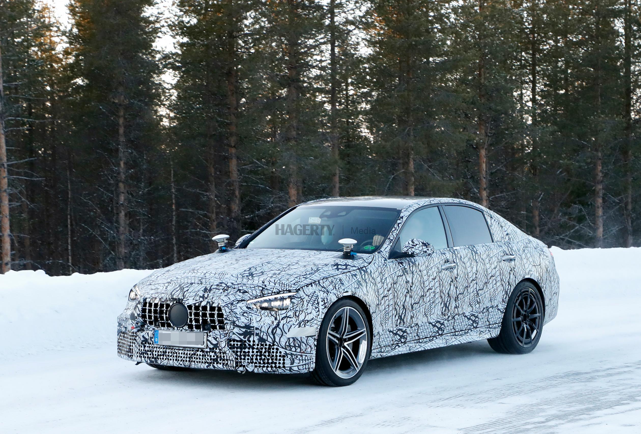 Mercedes AMG C63e camo spy front three-quarter