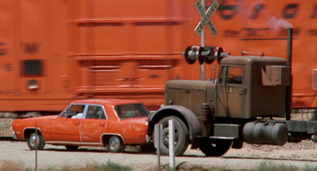 1971 Plymouth Valiant chase with tanker truck